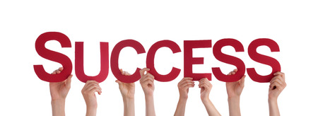succeeding: Many Caucasian People And Hands Holding Red Straight Letters Or Characters Building The Isolated English Word Success On White Background