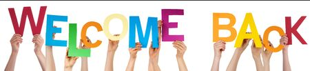welcome to: Many Caucasian People And Hands Holding Colorful  Letters Or Characters Building The Isolated English Word Welcome Back On White Background