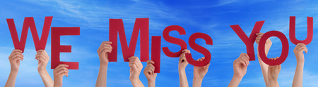 we the people: Many Caucasian People And Hands Holding Red Letters Or Characters Building The English Word We Miss You On Blue Sky