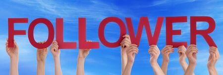 follower: Many Caucasian People And Hands Holding Red Straight Letters Or Characters Building The English Word Follower On Blue Sky