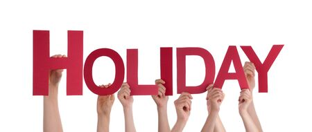 team building: Many Caucasian People And Hands Holding Red Straight Letters Or Characters Building The Isolated English Word Holiday On White Background
