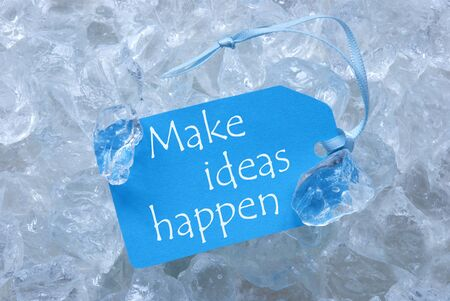 icecubes: Light Blue Label With Blue Ribbon On White Transparent Curshed Ice Cubes As Background. English Quote Make Ideas Happen For Cool Greetings.Close Up Or Macro View.