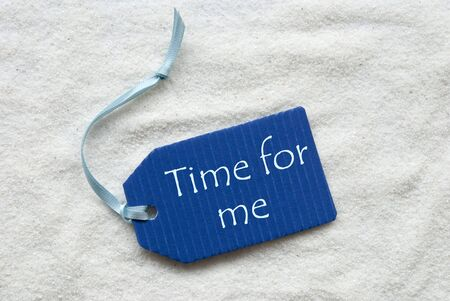 One Blue Label Or Tag With Light Blue Ribbon On White Sand Background With English Text Time For Me Stock Photo
