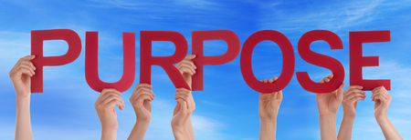 Many Caucasian People And Hands Holding Red Straight Letters Or Characters Building The English Word Purpose On Blue Sky Stock Photo