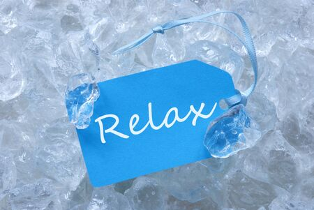 english text: Light Blue Label With Blue Ribbon On White Transparent Curshed Ice Cubes As Background. English Text Relax For Cool Greetings.Close Up Or Macro View.