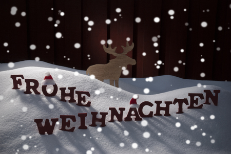 santa moose: Red Letters Building German Word Frohe Weihnachten Means Merry Christmas As Decoration Card. Snow And Snowy Scenery With Snowflakes Moose And Santa Hat. Wooden Background. Christmas Atmosphere
