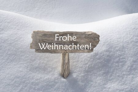christmas atmosphere: Wooden Christmas Sign With Snow In Snowy Scenery. German  Text Frohe Weihnachten Means Merry Christmas For Seasons Greetings Or Christmas Greetings. Christmas Atmosphere.