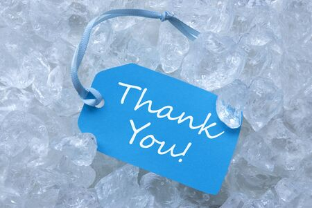 icecubes: Light Blue Label With Blue Ribbon On White Transparent Curshed Ice Cubes As Background. English Text Thank You For Cool Greetings.Close Up Or Macro View.