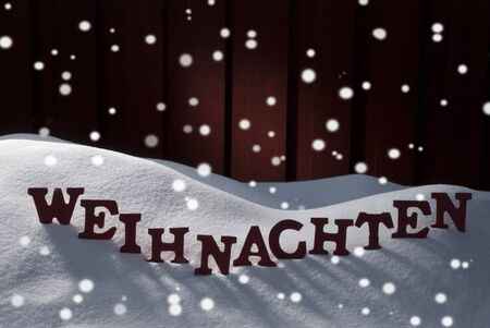 weihnachten: Red Letters Building German Word Weihnachten Means Christmas.Decoration Card For Seasons Greetings. Snow And Snowy Scenery With Snowflakes. Wooden Background. Christmas Atmosphere Stock Photo