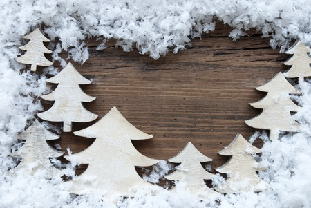 your text: Wooden  Background With White Christmas Trees And Snow. Vintage Style. Copy Space Free Text Or Your Text Here For Christmas Or Season Greetings