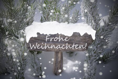 frohe: Wooden Christmas Sign With Snow And Fir Tree Branch In The Snowy Forest. German Text Frohe Weihnachten Means Merry Christmas For Seasons Greetings. Christmas Atmosphere With Snowflakes