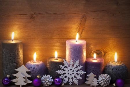 christmas decoration with purple and black candles christmas tree christmas ball snowflake