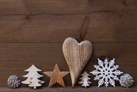 Wooden Background With Many Christmas Decoration.Heart, Snowfalke, Fir Cone, Christmas Tree, Star. Copy Space, Free Text Or Your Text Here. Rustic Or Vintage Style