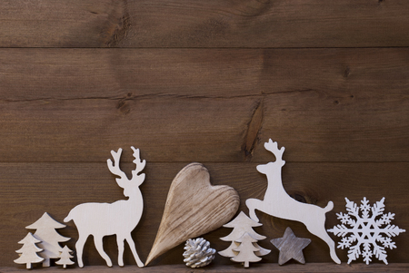 free christmas background: Wooden Background With Many Christmas Decoration.Heart, Snowfalke, Fir Cone, Christmas Tree, Star, Reindeer. Copy Space, Free Text Or Your Text Here. Rustic Or Vintage Style Stock Photo