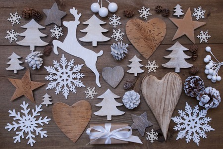 wood trade: Wooden Background With Many Christmas Decoration.Christmas Present, Heart, Snowfalke, Fir Cone, Star, Christmas Tree, Reindeer. Copy Space, Free Text Or Your Text Here. Rustic Or Vintage Style
