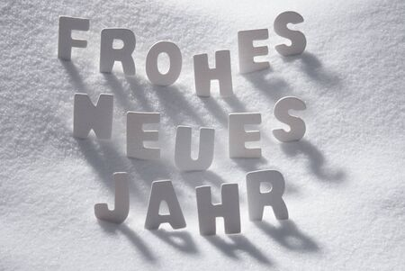 jahr: White Wooden Letters Building GermanText Frohes Neues Jahr Means Happy New Year. Snow And Snowy Scenery. Christmas Atmosphere. Christmas Background Or Christmas Card For Seasons Greetings