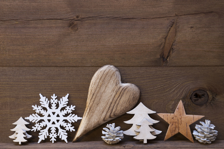 your text: Wooden Background With Many Christmas Decoration.Heart, Snowfalke, Fir Cone, Star, Christmas Tree. Copy Space, Free Text Or Your Text Here. Rustic Or Vintage Style