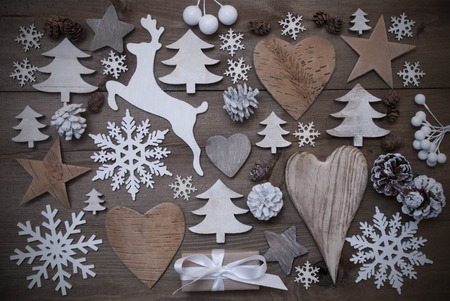 Wooden Background With Many Christmas Decoration.Christmas Present, Heart, Snowfalke, Fir Cone, Star, Christmas Tree, Reindeer. Copy Space, Free Text Or Your Text Here. Gray Rustic Or Vintage Style