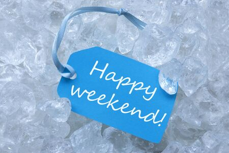icecubes: Light Blue Label With Blue Ribbon On White Transparent Curshed Ice Cubes As Background. English Text Happy Weekend For Cool Greetings.Close Up Or Macro View. Stock Photo
