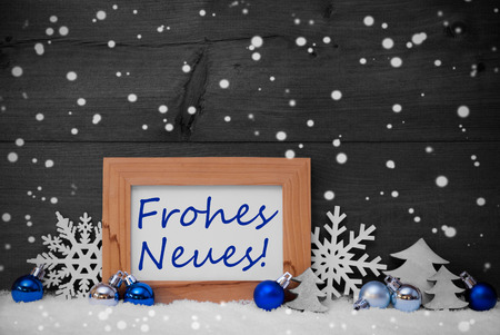 neues: Blue Gray Decoration On Snow. Christmas Tree Balls, Snowflakes And Christmas Tree. Picture Frame. German Text Frohes Neues Mean Happy New Year. Rustic, Vintage Brown Wooden Background. Black And White