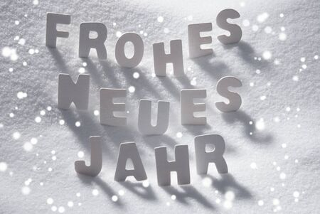 jahr: White Wooden Letters Building German Text Frohes Neues Jahr Means Happy New Year. Snow And Snowy Scenery, Snowfalkes. Christmas Atmosphere. Christmas Background Or Christmas Card For Seasons Greetings