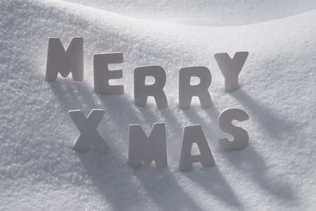 christmas atmosphere: White Wooden Letters Building English Text Merry Xmas. Snow And Snowy Scenery. Christmas Atmosphere. Christmas Background Or Christmas Card For Seasons Greetings