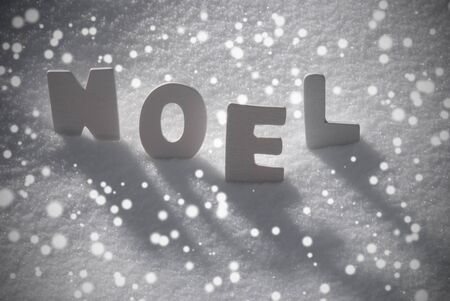 christmas atmosphere: White Wooden Letters Building French Text Noel Means Christmas. Snow And Snowy Scenery With Snowfalkes. Christmas Atmosphere. Christmas Background Or Christmas Card For Seasons Greetings