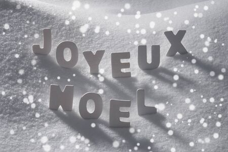 joyeux: White Wooden Letters Building French Text Joyeux Noel Means Merry Christmas. Snow And Snowy Scenery With Snowfalkes. Christmas Atmosphere. Christmas Background Or Christmas Card For Seasons Greetings