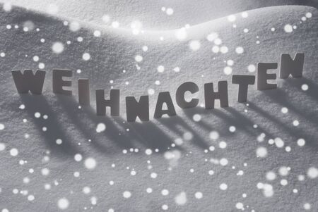 weihnachten: White Wooden Letters Building German Text Weihnachten Means Christmas. Snow And Snowy Scenery With Snowfalkes. Christmas Atmosphere. Christmas Background Or Christmas Card For Seasons Greetings Stock Photo