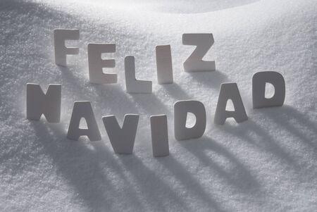 feliz navidad: White Wooden Letters Building Spanish Text Feliz Navidad Means Merry Christmas. Snow And Snowy Scenery. Christmas Atmosphere. Christmas Background Or Christmas Card For Seasons Greetings