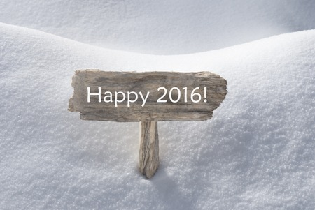 christmas atmosphere: Wooden Christmas Sign With Snow In Snowy Scenery. English Text Happy 2016 For Seasons Greetings Or Christmas Greetings Or Happy New Year Greetings. Christmas Atmosphere. Stock Photo