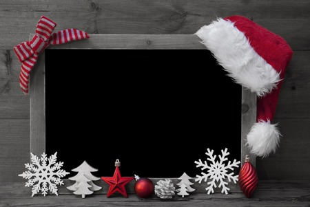 Black And White Christmas Chalkboard With Copy Space, Free Text. Red Christmas Decoration, Loop, Santa Hat, Christmas Ball, Christmas Tree, Snowflake. Wooden Background. Vintage Rustic Style. Stock Photo