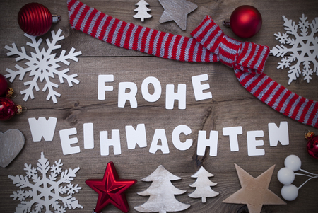 frohe: White Letters With German Frohe Weihnachten Means Merry Christmas On Brown Wooden Background.Gray Rustic, Vintage Style. Christmas Decoration, Christmas Tree,Snowflakes,Red Christmas Ball,Striped Loop