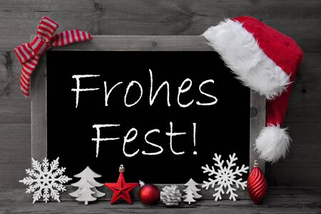 black and white cone: Black And White Blackboard With Red Santa Hat And Christmas Decoration like Snowflake, Tree, Christmas Ball, Fir Cone, Star. German Text Frohes Fest Means Merry Christmas. Wooden Background