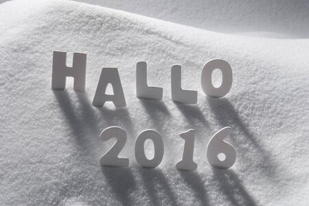 hallo: White Wooden Letters Building German Text Hallo 2016 Means Hello 2016. Snow And Snowy Scenery. Christmas Atmosphere. Christmas Background Or Christmas Card For Seasons Greetings