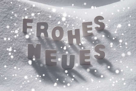 christmas atmosphere: White Wooden Letters Building German Text Frohes Neues Means Happy New Year. Snow And Snowy Scenery With Snowfalkes. Christmas Atmosphere. Christmas Background Or Christmas Card For Seasons Greetings