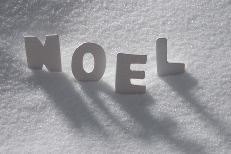 christmas atmosphere: White Wooden Letters Building French Text Noel Means Christmas. Snow And Snowy Scenery. Christmas Atmosphere. Christmas Background Or Christmas Card For Seasons Greetings Stock Photo