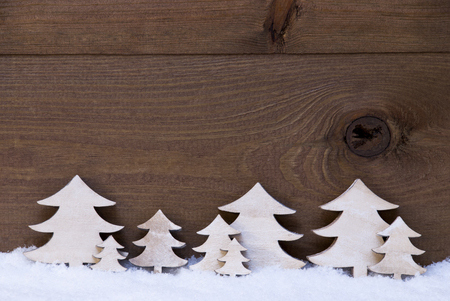 White Wooden Christmas Trees On Snow. Christmas Decoration Or Christmas Card. Brown, Rustic, Vintage Background With Copy Space For Advertisement Or Seasons Greetings.