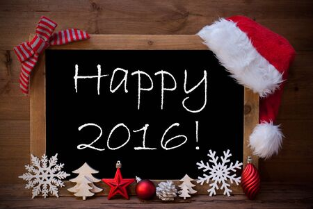 like english: Blackboard With Red Santa Hat And Christmas Decoration like Snowflake, Tree, Christmas Ball, Fir Cone, Star. English Text Happy 2016. Brown Wooden Background