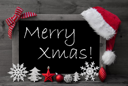 black and white cone: Black And White Blackboard With Red Santa Hat And Christmas Decoration like Snowflake, Tree, Christmas Ball, Fir Cone, Star. English Text Merry Xmas. Wooden Background