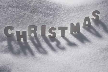english text: White Wooden Letters Building English Text Christmas. Snow And Snowy Scenery. Christmas Atmosphere. Christmas Background Or Christmas Card For Seasons Greetings