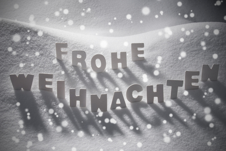 frohe: White Wooden Letters Building German Text Frohe Weihnachten Means Merry ChristmasSnow And Snowy Scenery, Snowfalkes. Christmas Atmosphere. Christmas Background Or Christmas Card For Seasons Greetings