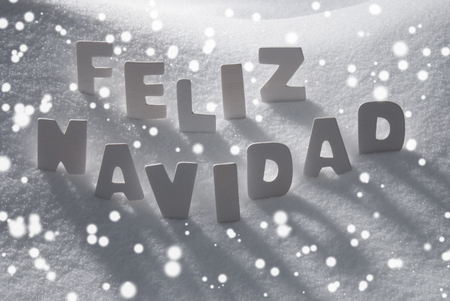 White Wooden Letters Building Spanish Text Feliz Navidad Means Merry Christmas. Snow And Snowy Scenery, Snowfalkes. Christmas Atmosphere. Christmas Background Or Christmas Card For Seasons Greetings