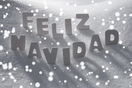 feliz navidad: White Wooden Letters Building Spanish Text Feliz Navidad Means Merry Christmas. Snow And Snowy Scenery, Snowfalkes. Christmas Atmosphere. Christmas Background Or Christmas Card For Seasons Greetings