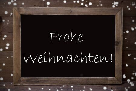 frohe: Brown Blackboard With German Text Frohe Weihnachten Means Merry Christmas As Greeting Card. Wooden Background. Vintage Rustic Style. Snowflakes Symbolizing Christmas Or Winter Season.