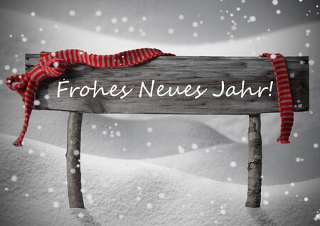 jahr: Gray Wooden Christmas Sign On White Snow. Snowy Scenery, Snowflakes. Red Ribbon, GermanText Frohes Neues Jahr Mean Happy New Year. Christmas Decoration, Card. Rustic Or Vintage Syle.