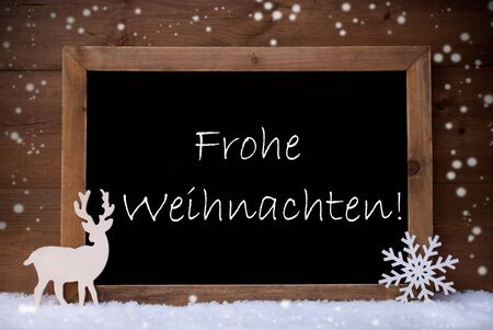 weihnachten: Brown Christmas Card With Chalkoard, Reindeer And Snowflake On White Snow, Snowflakes. Rustic Vintage Wooden Background. Snowy Decoration With German Text Frohe Weihnachten Mean Merry Christmas.