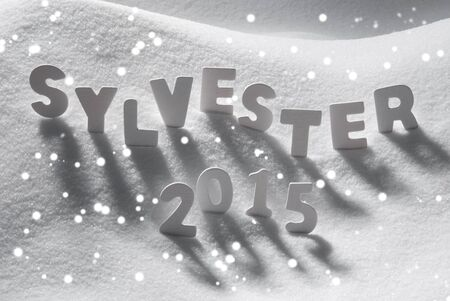 sylvester: White Letters Building German Text Sylvester 2015 Means New Years Eve 2015 On White Snow. Snowy Landscape Or Scenery With Snowflakes. Christmas Card For Seasons Greetings Or Usable As Background.