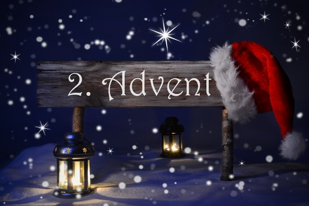 advent candles: Wooden Christmas Sign And Santa Hat With Snow In Snowy Scenery. German Text 2. Advent Means Christmas Time For Seasons Greetings. Blue Silent Night Snowflakes Sparkling Stars Lantern And Candlelight