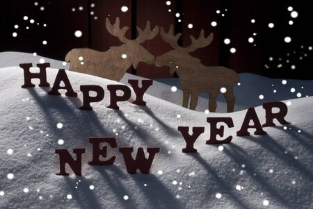 realtionship: Red Letters On White Snow With Snowflakes As Christmas Card.  English Text Or Word Happy New Year. Moose Couple In Love In Snowy Scenery And Atmosphere. Rustic Vintage Wooden Background Stock Photo